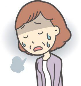 ストレスが溜まり、ため息ばかりの女性